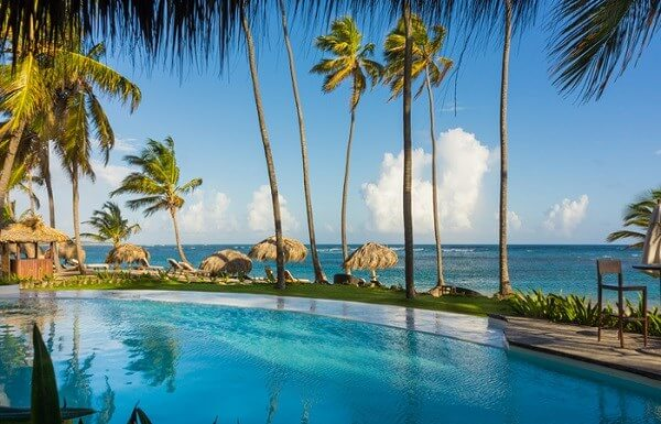 Pool and palm trees in Punta Cana